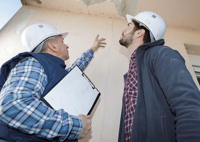 inspecting water damage in basement in RI